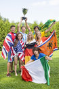 Athletes with various national flags celebrating in park portrait of successful Stock Photography