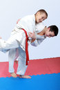 Athletes with a white and red sash do judo throw Stock Photos