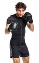 Athletic attractive man wearing boxing gloves on the white background Stock Images
