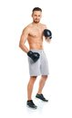 Athletic attractive man wearing boxing gloves on the white background Stock Photography