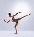 Athletic ballet dancer performing in a studio Royalty Free Stock Photo