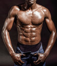 Athletic black man on black background Royalty Free Stock Photo