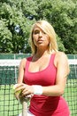 Athletic blond girl holding tennis ball racket Royalty Free Stock Photos