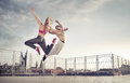 Athletic couple during the jump training hard Royalty Free Stock Photography