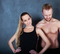 Athletic couple near the wall men and women with Royalty Free Stock Photo