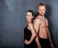 Athletic couple near the wall men and women Royalty Free Stock Photo