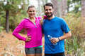Athletic couple standing together in forest Royalty Free Stock Photo