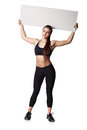Athletic fitness woman with sign board blank helthy sport isolated white background black clothes Royalty Free Stock Photo