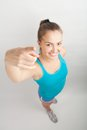 Athletic girl beautiful sports stretches out her hand towards the camera Stock Image