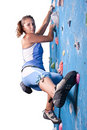 Athletic girl climbing Stock Images