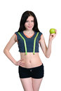 Athletic girl with measuring tape and apple isolation smiling in sportswear Royalty Free Stock Photo