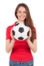 Athletic girl red shirt holding soccer ball Stock Images