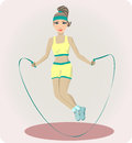 Athletic girl with a skipping rope in sports form jumping Stock Images