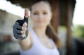 Athletic girl woman athlete shows thumb lifted upwards Stock Photography