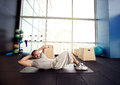 Athletic man doing abdominals at gym Stock Photo