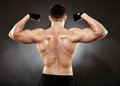 Athletic man doing bodybuilding moves for the back muscles studio shot of bodybuilder showing his Stock Images