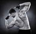 Athletic man doing bodybuilding moves studio shot of young Royalty Free Stock Image