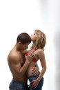 Athletic man hugging shapely woman men women on white background Royalty Free Stock Photography