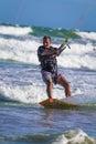 Athletic man jump on kite surf board sea waves Royalty Free Stock Photo