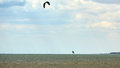Athletic man jump on kite surf board Royalty Free Stock Photo