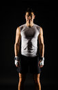 Athletic man relaxing with fit body black background Stock Photography