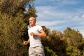Athletic man runner jogging in nature outdoor Royalty Free Stock Photo