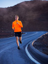 Athletic man running outside training outdoors jogging on road Royalty Free Stock Images