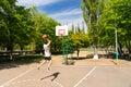 Athletic Man Taking Jump Shot on Basketball Court