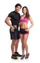 Athletic man and woman with dumbbells on the white background couple men women Royalty Free Stock Photos
