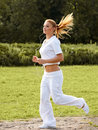 Athletic runner training in a park for marathon fitness girl r running outdoors Stock Image
