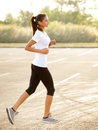 Athletic runner training in a park for marathon fitness girl r running outdoors Stock Images