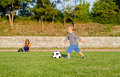 Athletic small boy playing soccer Stock Photo