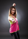 Athletic woman dancing and doing zumba moves studio shot of young over gray background Royalty Free Stock Photography