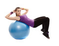 Athletic woman doing abs crunched on the ball studio shot of young crunches isolated over white background Stock Images