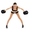 Athletic woman doing dumbbells young exercising with isolated on white background Stock Images
