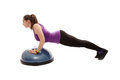 Athletic woman doing pushups on a bosu ball studio shot of young isolated over white background Royalty Free Stock Photography