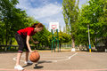 Athletic Woman Dribbling Basketball at Mid Court Royalty Free Stock Photo
