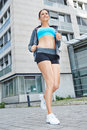 Athletic woman jogging in the city young happy Stock Photo