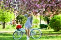 Athletic woman ride retro bicycle. Rest and travel. Travel by bike. Weekend concept. Spring holidays. Riding bicycle Royalty Free Stock Photo