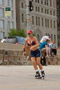 Athletic Woman Rollerblades On Urban Street Royalty Free Stock Photo