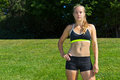 Athletic woman in a sports bra and shorts fit Royalty Free Stock Image