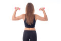 Athletic woman turning her back with  hair holding two dumbbells Royalty Free Stock Photo