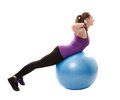 Athletic woman working her back muscles on the ball studio shot of young isolated over white background Royalty Free Stock Image