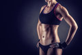 Athletic woman young on a black background Royalty Free Stock Images