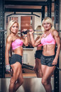 Athletic women showing muscles Royalty Free Stock Photo