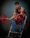 Athletic young man lifting weights Royalty Free Stock Photo