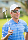 Athletic young man playing golf portrait of golfer on course with putter Royalty Free Stock Photo