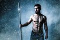 Athletic young man with spear Royalty Free Stock Photo