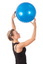 Athletic young woman with blue ball Royalty Free Stock Image