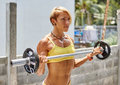 Athletic young woman doing workout with barbell outdoor Royalty Free Stock Photo